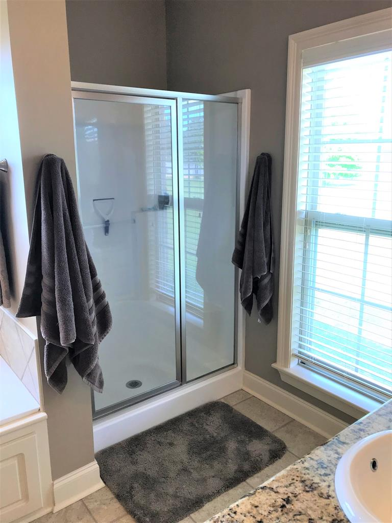 Separate shower in this master bath